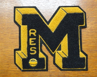 Vintage 1950s 1960s chenille sew on M Letterman patch college high school varsity basketball black gold American