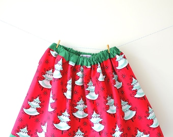 Christmas tree skirt in red with a gorgeous white and green Christmas tree print, fully lined in green with an elasticated waist