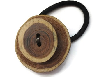 Elastic band for hair in wood puck