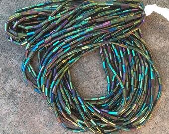 Green iris glass bugle beads size 2