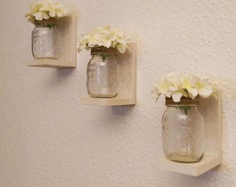 Amazing southern Rustic Chic Mason Jar white floating shelves  made from reclaimed wood and hand painted jars.