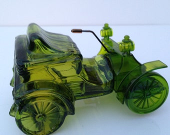 AVON COLLECTIBLE  CAR is a Vintage Green 1902 Haynes-Apperson Empty Bottle Created for Avon Blend 7 After Shave - now an Avon Collectible