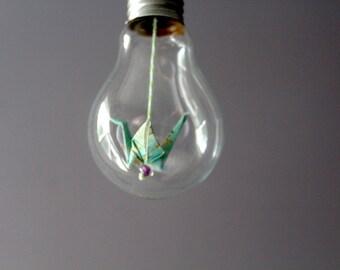 Origami crane in a bulb