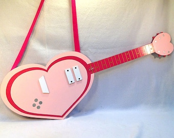 Cyan's Strawberry Heart Guitar