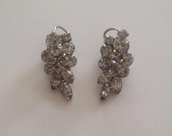 Vintage rhinestone layered silver tone clip earrings. Wedding earrings