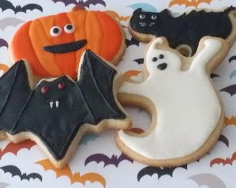Halloween decorated sugar cookies, ghost decorated cookie, pumpkin decorated cookie, bat decorated cookie, pumpkin decorated cookie