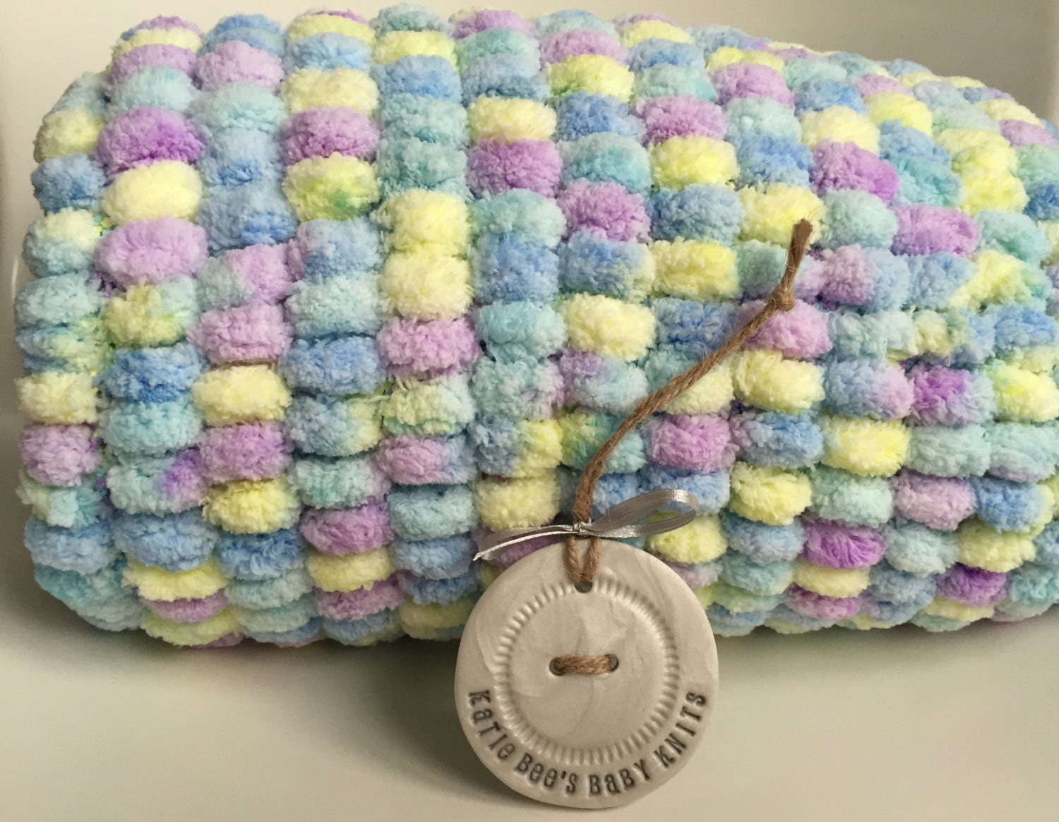 Knitting Pattern For Pom Pom Blanket : Pom pom baby blanket Hand knitted Blue Yellow Purple