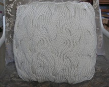 Patterned hand knitted cushion