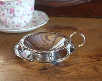 Vintage silver plate tea strainer and underdish