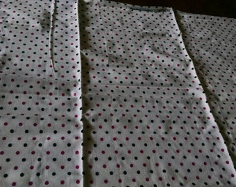 Black and pink polka dot fabric remnant