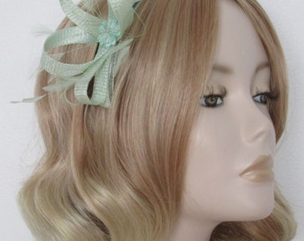 MINT GREEN FASCINATOR, Made of Sinamay, with feathers, Satin beaded flower and butterfly, on a comb