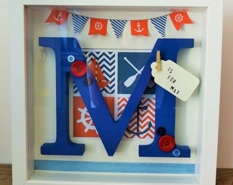 Framed initial with a design of your choice