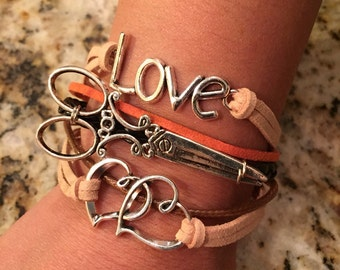 Leather scissor bracelet with silver metal scissor, hearts, and love! Stylish!