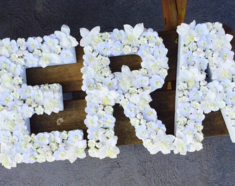 White floral letters