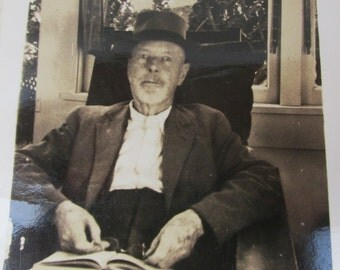 Vintage 1950s Black and White Photograph - Old Man in Hat Reading