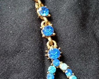 Gold chain with blue and aqua gemstones