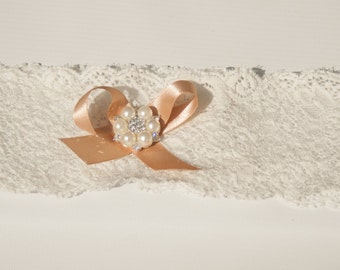 Vintage style lace wedding garter with pearls and crystals. A gently elasticated ivory wedding garter perfect for the bride who love vintage