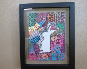 Hand-drawn zentangle-like colorful zen doodle with bunny motif  floating in black metal frame 9 x 11 strong blue pink green colors