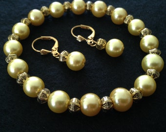 Gold glass pearl and Antique Gold metal plated bracelet ensemble