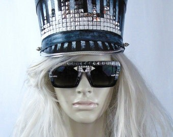 Burning man, accessory, black marching band hat with hand painted silver/white stripes and an equalizer stud detail with spike accents
