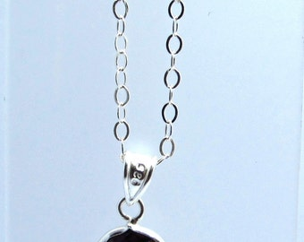 Sterling Silver faceted purple pendant