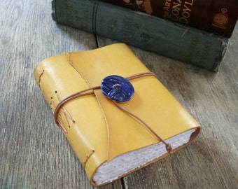 """Leather Journal . """"Live in the sunshine, swim the sea, drink the wild air"""" -Ralph Waldo Emerson . yellow hand-dyed & blue button (320 pgs)"""