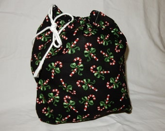 "Christmas Fabric Gift Bag  Eco Friendly Drawstring Bag----Reuseable size 10.5"" wide x 10.5"" tall Black with Candy Canes"