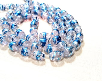 Blue and Clear Oval Crackle Glass Beads, a Strand is 32 inches, 11x8mm Oval Glass Beads with Blue Accents over clear crackle Glass. GBW 091C