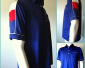 Vintage 70s JC Penney Men's Navy Blue Polo with Red, White, and Blue Sleeve Size L