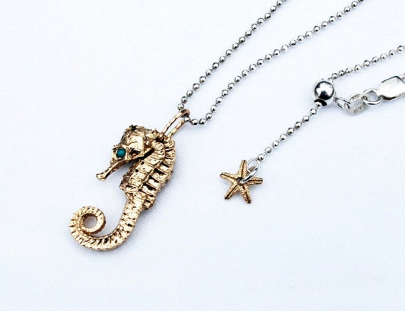 Solid 10k Yellow Gold Seahorse with Genuine Turquoise Eyes, hung on Sterling Silver Chain