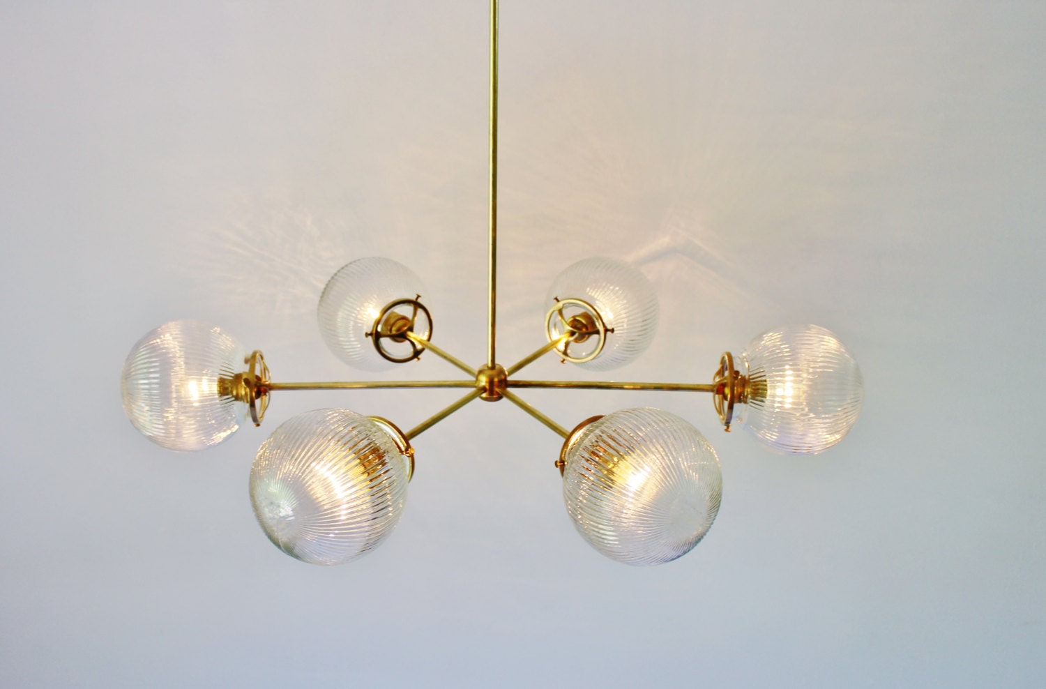 Modern brass chandelier with clear ribbed holophane glass - Can light chandelier ...