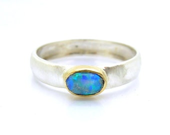 Opal ring set in yellow gold and sterling silver band
