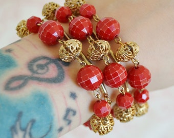 Vintage Bracelet with Red Plastic and Gold Tone Metal Beads