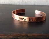 Copper or brass 'love is...' bangle cuff phrase bracelet