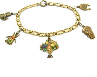 Art Deco Charm Bracelet. Cupid, Good Luck Horseshoe, Rhinestone Insect, Enamel Flower Basket, Asian Fu Manchu Man. Vintage 1930s Jewelry.