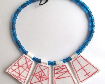 Bib necklace hot pink pendants with transparent blue glass Native American trade beads blue Ghanian toggle geometric design hand embroidered