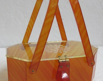 """On Sale! 1950's Amber Marbleized """"Patricia"""" Lucite Purse With Carved Floral Motif And Basket Handles"""