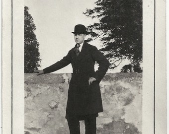 Old Photo Man wearing Coat and Bowler Hat Stone Wall Shadow 1920s Photograph snapshot vintage