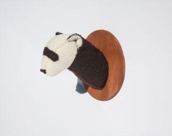 Ferret faux taxidermy on wooden mount