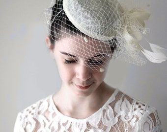Vintage Queen Pill Box Style Hat with Birdcage Blusher Veil in Cream