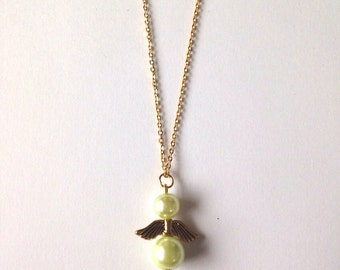Angel pendant necklace with green pearls and gold-plated wings