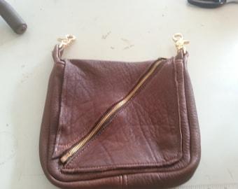 Brown elk hide pouch brass zipper closure