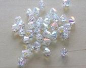 Bicone Swarovski #5301  Crystal AB  Color.