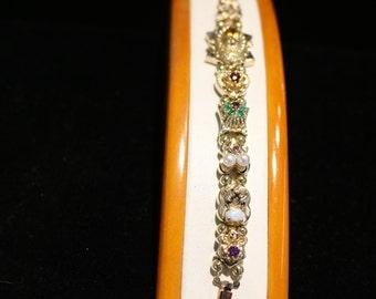 Slide Bracelet,14k yellow gold, with precious & semi precious stones. Circa 1960's