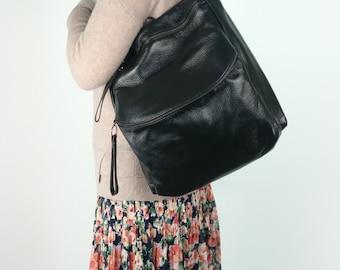 Leraje Convertible Backpack | Shoulder bag - black, made of  rich shrunken leather. wear it as a backpack or shoulder bag