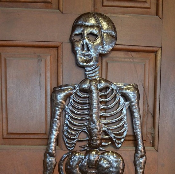 "Hanging Skeleton, Haitian Metal Art, Hand pounded made from a 55 gallon metal barrel 17"" x 51"""