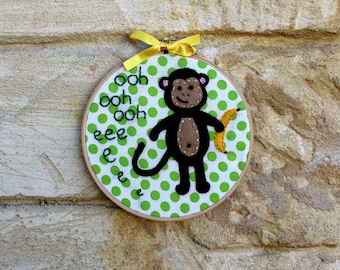 Embroidered monkey hoop art: Felt monkey, hand stitched on polka dot fabric