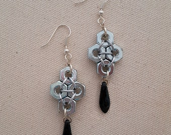 Silver colored hex nut jet marbled dagger earrings
