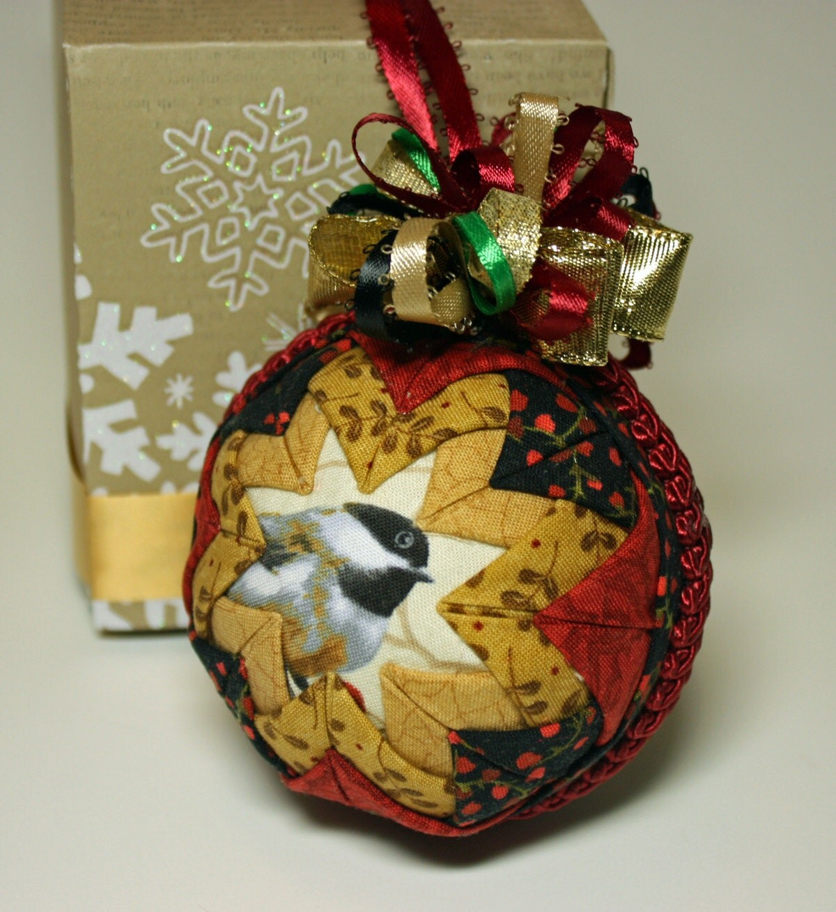 Folded fabric quilted star christmas ornament with chickadee