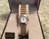 Jules Jurgensen Ladies Gold Tone Tanzanite Rhodolite Genuine Gemstone Watch